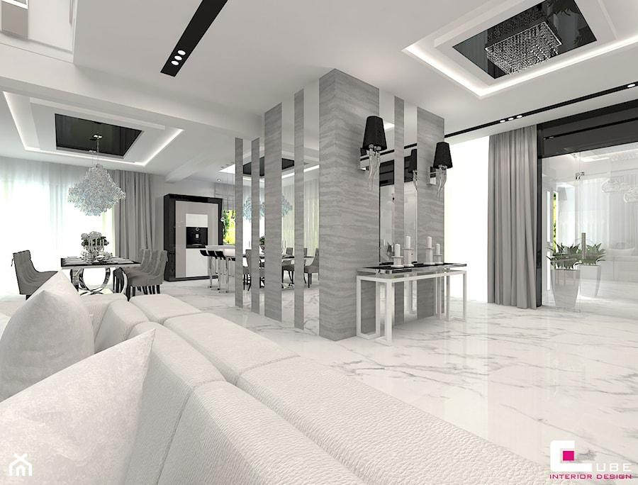 Aranżacje wnętrz - Hol / Przedpokój: Projekt wnętrz domu w Wołominie - Średni biały hol / przedpokój, styl glamour - CUBE Interior Design. Przeglądaj, dodawaj i zapisuj najlepsze zdjęcia, pomysły i inspiracje designerskie. W bazie mamy już prawie milion fotografii!