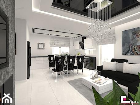 Aranżacje wnętrz - Jadalnia: DOM POD LEGNICĄ - Duża otwarta biała jadalnia w kuchni w salonie, styl glamour - CUBE Interior Design. Przeglądaj, dodawaj i zapisuj najlepsze zdjęcia, pomysły i inspiracje designerskie. W bazie mamy już prawie milion fotografii!