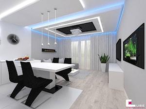 Mieszkanie w Mińsku Mazowieckim 70 m2 - Średnia otwarta biała szara jadalnia w salonie, styl nowoczesny - zdjęcie od CUBE Interior Design