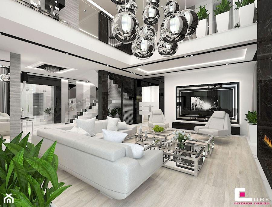 Aranżacje wnętrz - Salon: Projekt wnętrz domu w Wołominie - Duży biały czarny salon z antresolą, styl glamour - CUBE Interior Design. Przeglądaj, dodawaj i zapisuj najlepsze zdjęcia, pomysły i inspiracje designerskie. W bazie mamy już prawie milion fotografii!