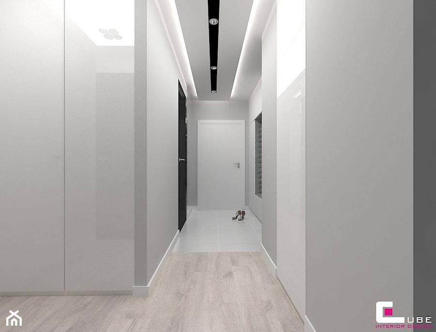 Mieszkanie w Mińsku Mazowieckim 70 m2 - Mały biały szary hol / przedpokój, styl nowoczesny - zdjęcie od CUBE Interior Design