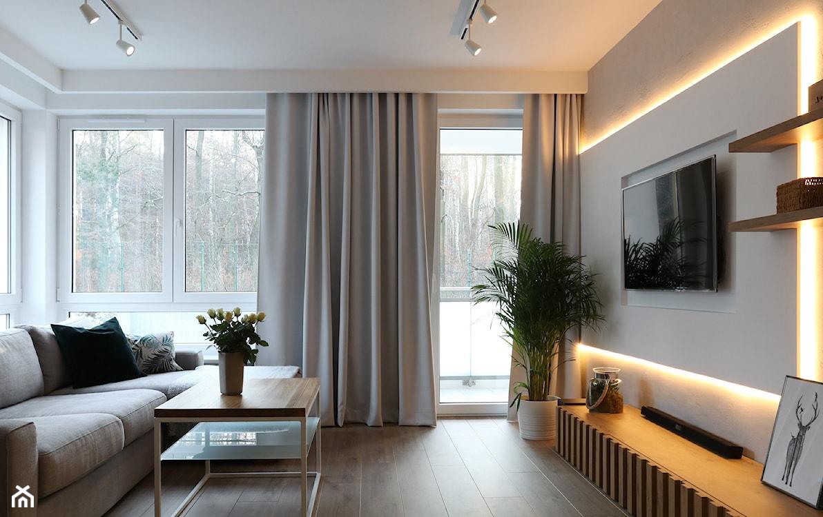listwy oświetleniowe w salonie skandynawskim