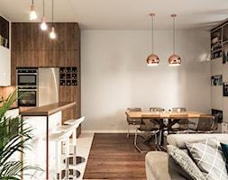 Apartament - Garnizon - Średnia otwarta szara jadalnia w kuchni w salonie, styl nowoczesny - zdjęcie od Autors.KA - Homebook
