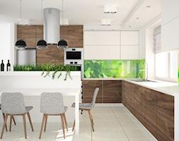 Projekt kuchni z zielonym akcentem - Duża otwarta zielona kuchnia w kształcie litery l z oknem, styl nowoczesny - zdjęcie od OES architekci