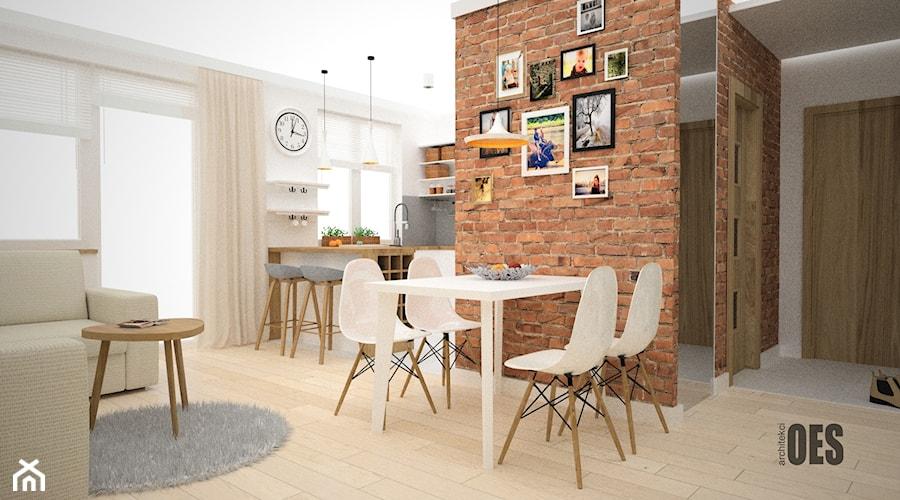 Kuchnia w stylu skandynawskim - Mały biały salon z kuchnią z jadalnią z tarasem / balkonem, styl skandynawski - zdjęcie od OES architekci