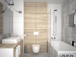 Łazienka w szarościach z drewnem