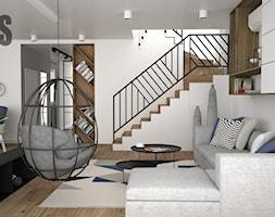 Niebieskie akcenty we wnętrzu - Mały biały salon z jadalnią, styl nowoczesny - zdjęcie od OES architekci