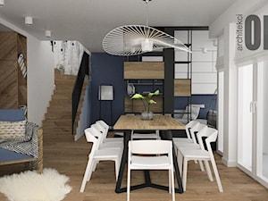 Niebieskie akcenty we wnętrzu - Mały szary biały salon z kuchnią z jadalnią, styl nowoczesny - zdjęcie od OES architekci