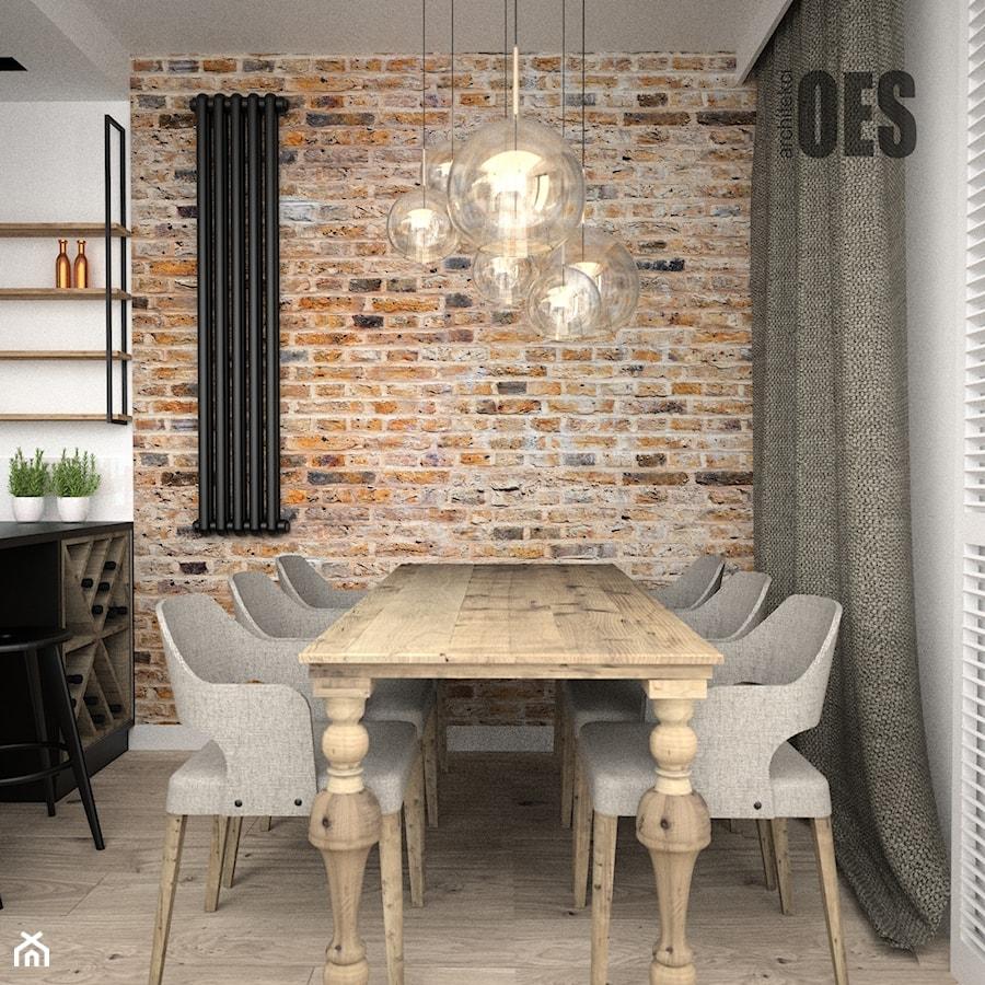 Aranżacje wnętrz - Jadalnia: Kuchnia industrialna - Średnia otwarta szara jadalnia w kuchni w salonie, styl industrialny - OES architekci. Przeglądaj, dodawaj i zapisuj najlepsze zdjęcia, pomysły i inspiracje designerskie. W bazie mamy już prawie milion fotografii!