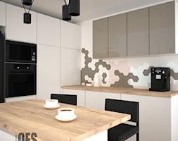 Kuchnia z mchem - Średnia otwarta biała czarna kuchnia w kształcie litery l z wyspą, styl nowoczesn ... - zdjęcie od OES architekci - Homebook