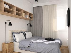Minimalistyczna sypialnia z zabudową nad łóżkiem