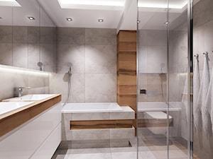 łazienka z nuta szarosci i drewna.