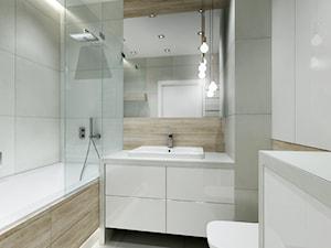 Mieszkanie w Bydgoszczy - Mała biała łazienka w bloku w domu jednorodzinnym bez okna, styl nowoczesny - zdjęcie od All Design Agnieszka Lorenc
