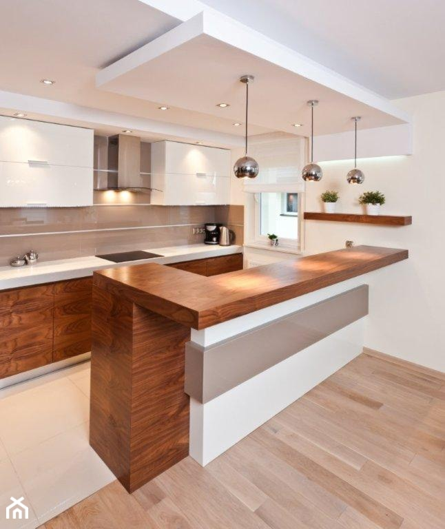 Duża otwarta biała kuchnia w aneksie z wyspą, styl nowoczesny - zdjęcie od All Design Agnieszka Lorenc - Homebook