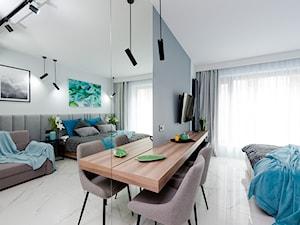 Realizacja projektu mieszkania na wynajem krótkoterminowy Kraków - Średni szary salon z jadalnią, styl nowoczesny - zdjęcie od All Design Agnieszka Lorenc