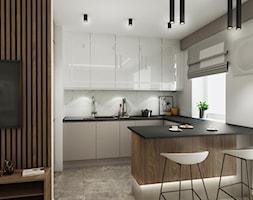 Mieszkanie z kolorem koniaku - Średnia biała kuchnia w kształcie litery g w aneksie z wyspą z oknem, styl nowoczesny - zdjęcie od All Design Agnieszka Lorenc