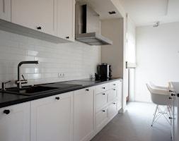 Dom pod Poznaniem - projekt wnętrz - Duża otwarta biała kuchnia jednorzędowa w aneksie z wyspą, styl skandynawski - zdjęcie od Sasiak-Sobusiak Pracownia Projektowa