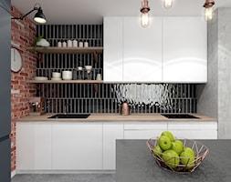 Projekt Mieszkania w stylu nowoczesno-industrialnym - Mała szara czarna brązowa kuchnia jednorzędowa w aneksie z wyspą, styl industrialny - zdjęcie od PIKA DESIGN