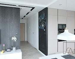 MIESZKANIE POZNAŃ WILDA // REALIZACJA - Mała otwarta biała czarna jadalnia w kuchni w salonie, styl nowoczesny - zdjęcie od SZTYBLEWICZ_architekci