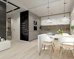 MIESZKANIE // POZNAŃ // WILDA - Mała otwarta biała czarna szara jadalnia w kuchni, styl nowoczesny - zdjęcie od SZTYBLEWICZ_architekci