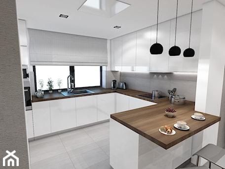 Aranżacje wnętrz - Kuchnia: Ujmujący minimalizm - Marengo Architektura Wnętrz Anna Knofliczek-Roman. Przeglądaj, dodawaj i zapisuj najlepsze zdjęcia, pomysły i inspiracje designerskie. W bazie mamy już prawie milion fotografii!