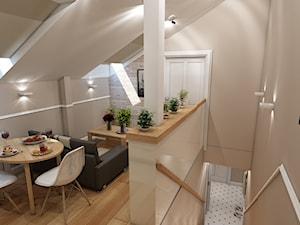 Mieszkanie na poddaszu w kamienicy Kraków Stare Miasto - Mała otwarta beżowa jadalnia w salonie, styl klasyczny - zdjęcie od marengo-architektura