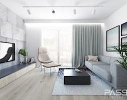 Projekt 25 - Średni szary biały salon z tarasem / balkonem, styl nowoczesny - zdjęcie od PASS architekci