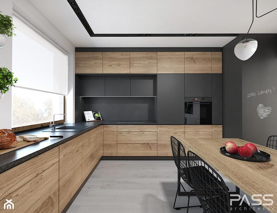 Projekt 27 - Duża zamknięta biała czarna kuchnia w kształcie litery l w aneksie z oknem, styl nowoczesny - zdjęcie od PASS architekci