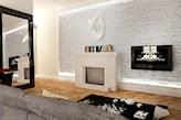 ceglana ściana, drewniana podłoga, szara sofa