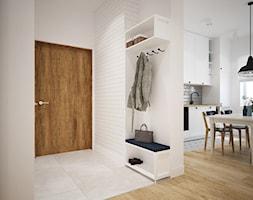 Projekt mieszkania w Poznaniu - Mały biały hol / przedpokój, styl skandynawski - zdjęcie od marina suchorska architektura wnętrz