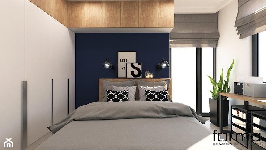 Aranżacje wnętrz - Sypialnia: SYPIALNIA RUCZAJ - Mała biała niebieska sypialnia dla gości na poddaszu, styl industrialny - FORMA - Pracownia Architektury Wnętrz i Krajobrazu. Przeglądaj, dodawaj i zapisuj najlepsze zdjęcia, pomysły i inspiracje designerskie. W bazie mamy już prawie milion fotografii!