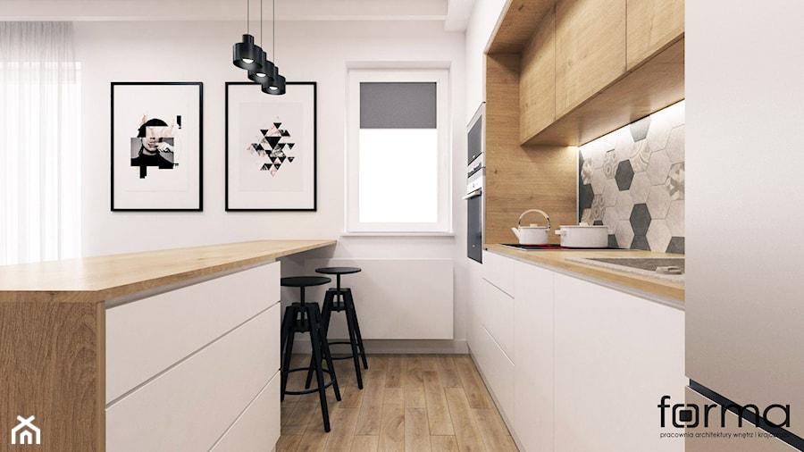 MIESZKANIE KUZNICA KOŁŁĄTAJOWSKA - Średnia biała kuchnia dwurzędowa w aneksie z wyspą z oknem, styl skandynawski - zdjęcie od FORMA - Pracownia Architektury Wnętrz