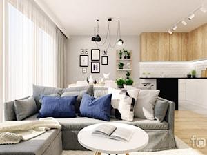 DOM ZIELNA - Średni szary biały salon z kuchnią z jadalnią, styl skandynawski - zdjęcie od FORMA - Pracownia Architektury Wnętrz