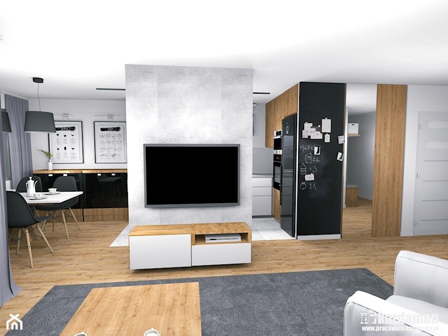 Ciepłe szarości w bloku ze ścianką TV - Średni biały czarny salon z kuchnią z jadalnią, styl nowoczesny - zdjęcie od Pracownia Kardamon