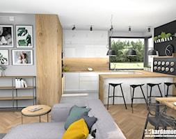 Przytulny dom w Zabierzowie k. Krakowa - Średnia otwarta biała czarna kuchnia w kształcie litery g w aneksie z oknem, styl nowoczesny - zdjęcie od Pracownia Kardamon