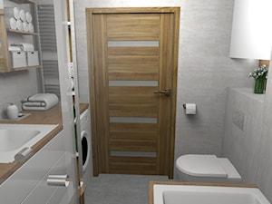 Elegancka szara łazienka z ciepłym drewnem - Mała szara łazienka w bloku w domu jednorodzinnym bez okna, styl nowoczesny - zdjęcie od Pracownia Kardamon
