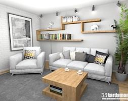 Ciepłe szarości w bloku ze ścianką TV - Średni szary salon z bibiloteczką, styl tradycyjny - zdjęcie od Pracownia Kardamon