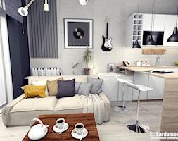 Kiedyś będziemy dorośli - niedługo - ale jeszcze nie teraz - Mały szary biały czarny salon z kuchnią z jadalnią, styl industrialny - zdjęcie od Pracownia Kardamon