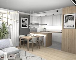 Ciepły minimalizm - Średnia otwarta biała szara kuchnia w kształcie litery g w aneksie z oknem, styl minimalistyczny - zdjęcie od Pracownia Kardamon