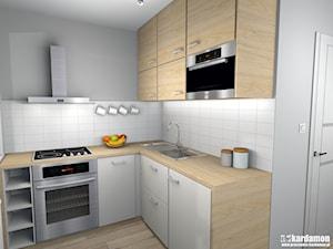 Zgrabne mieszkanie pod wynajem 27m2 - Mała otwarta biała szara kuchnia w kształcie litery l, styl minimalistyczny - zdjęcie od Pracownia Kardamon