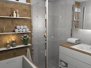 Elegancka szara łazienka z ciepłym drewnem
