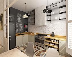 Średnia otwarta biała czarna kuchnia w kształcie litery l w aneksie, styl skandynawski - zdjęcie od Krystyna Regulska Architektura Wnętrz