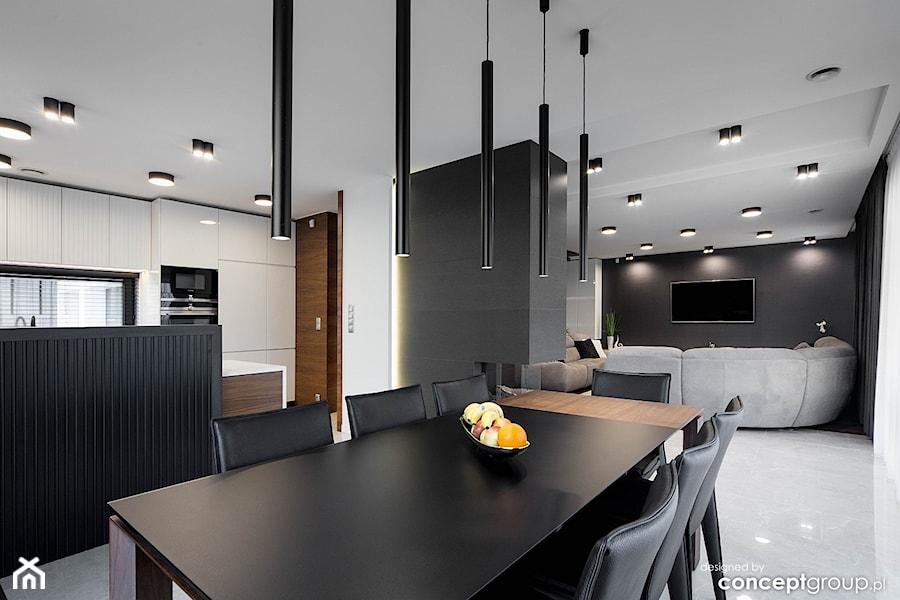 Jadalnia, kuchnia, salon - zdjęcie od Conceptgroup