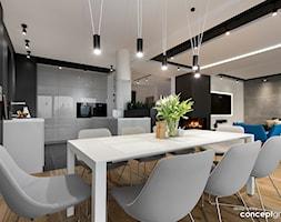 Dom w Dąbrowie Górniczej - Realizacja - Średnia otwarta biała czarna szara jadalnia w kuchni w salonie, styl nowoczesny - zdjęcie od Conceptgroup