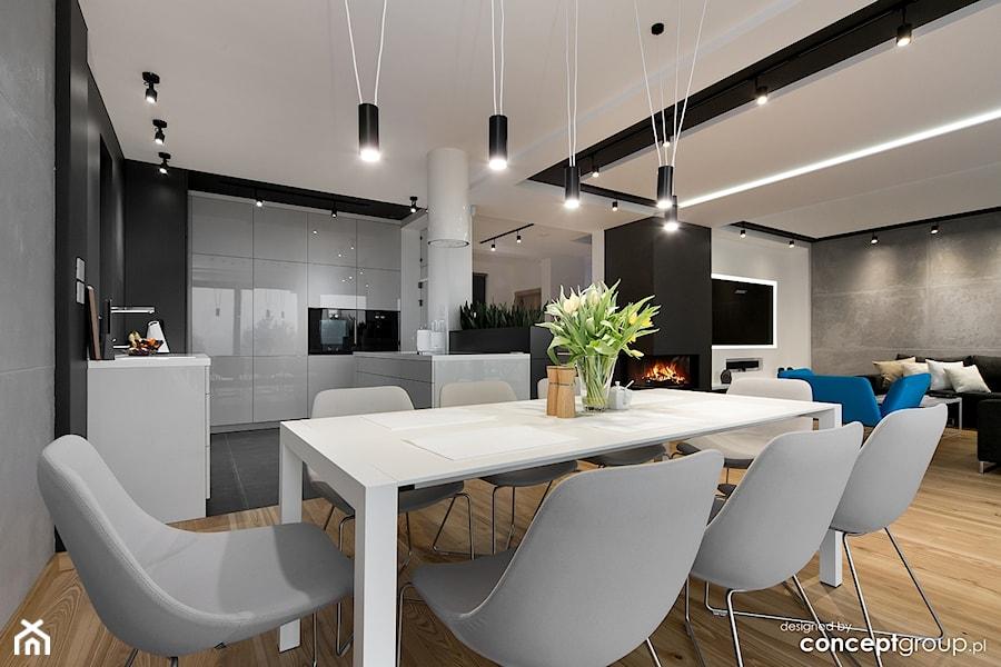 Aranżacje wnętrz - Jadalnia: Dom w Dąbrowie Górniczej - Realizacja - Średnia otwarta biała czarna szara jadalnia w kuchni w salonie, styl nowoczesny - Conceptgroup . Przeglądaj, dodawaj i zapisuj najlepsze zdjęcia, pomysły i inspiracje designerskie. W bazie mamy już prawie milion fotografii!