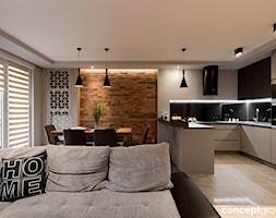 Dom w Rudzie Śląskiej - Realizacja - Mała otwarta wąska czarna kuchnia w kształcie litery g w aneksie, styl nowoczesny - zdjęcie od Conceptgroup