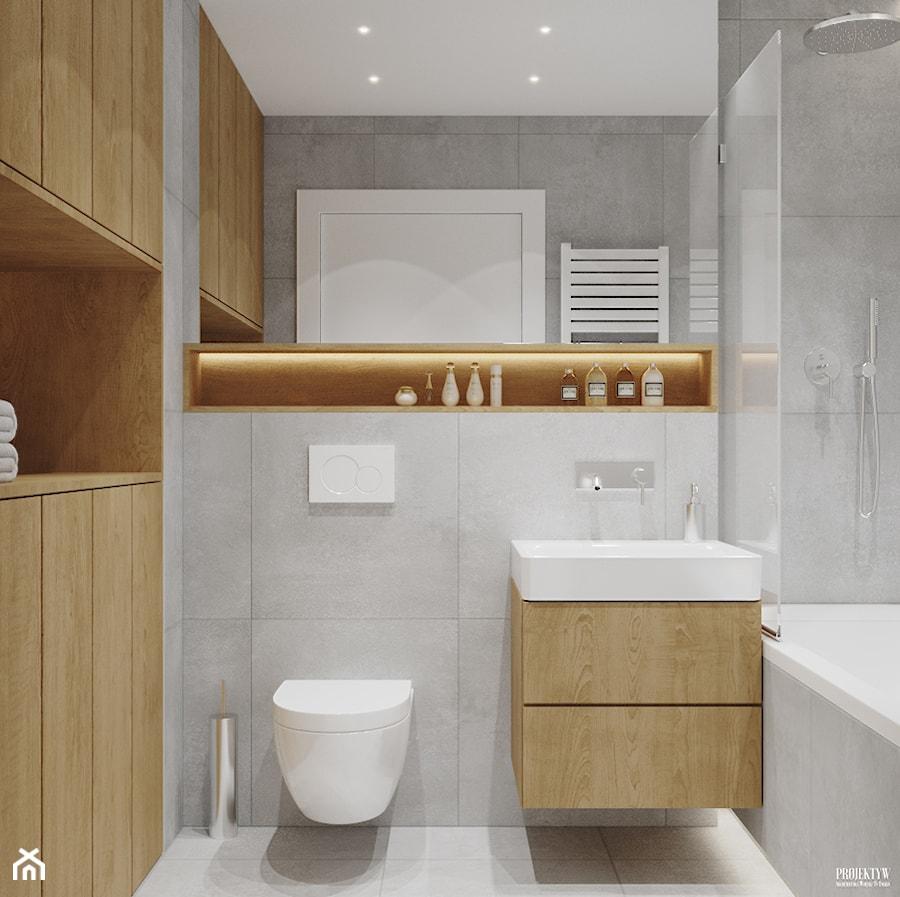 Projekt mieszkania. Kraków Nowe Czyżyny - Mała szara łazienka w bloku bez okna, styl skandynawski - zdjęcie od PRØJEKTYW | Architektura Wnętrz & Design