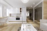 jasny długi salon w stylu nowoczesnym