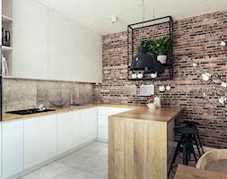 Mieszkanie w stylu loftowym w Krakowie - Średnia otwarta szara kuchnia w kształcie litery u w aneksie, styl industrialny - zdjęcie od MEEKO Architekci
