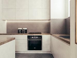 Mieszkanie w stylu skandynawskim w Warszawie - Duża zamknięta biała kuchnia w kształcie litery l z wyspą z oknem, styl skandynawski - zdjęcie od MEEKO Architekci